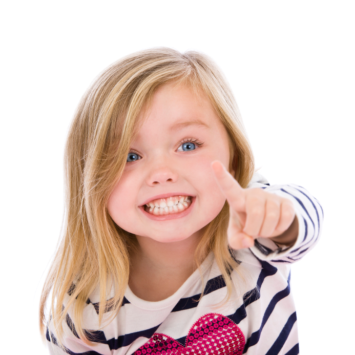 Two year old girl points at the camera with a big smile