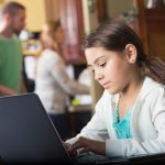 young girl on computer