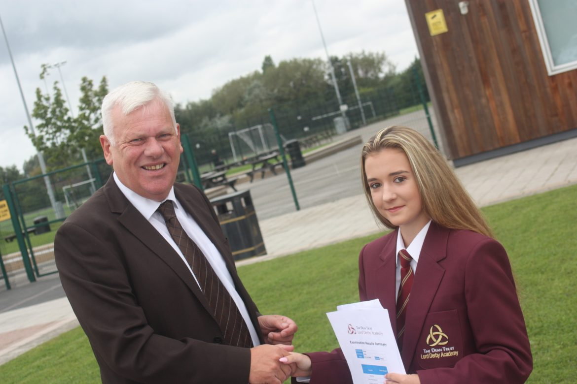 Cllr Graham Morgan congratulates Lord Derby Academy pupil Emma Kelly, who made excellent progress from KS2, gaining 10 GCSES Grade C+ inc. 1 A*