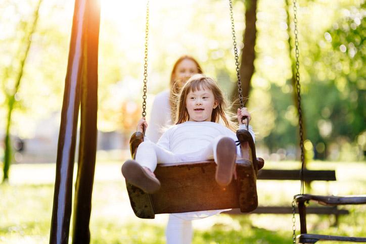 Disable child enjoying the swing