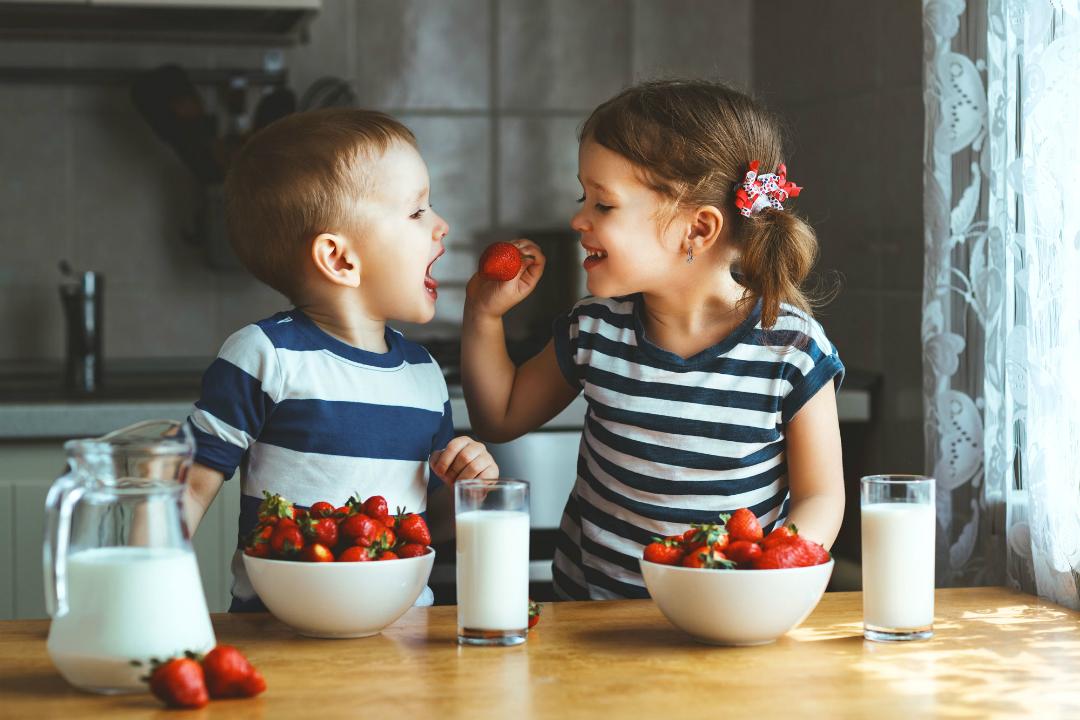 Children eating strawberries