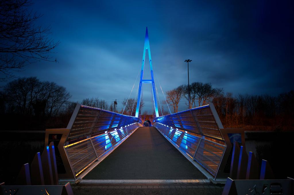 Greystone Bridge lit up in blue