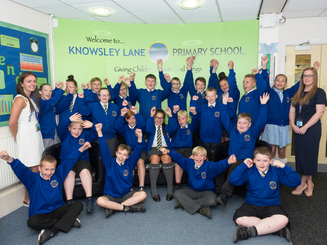 Children from Knowsley Lane Academy in Huyton celebrate the school's Key Stage 2 results