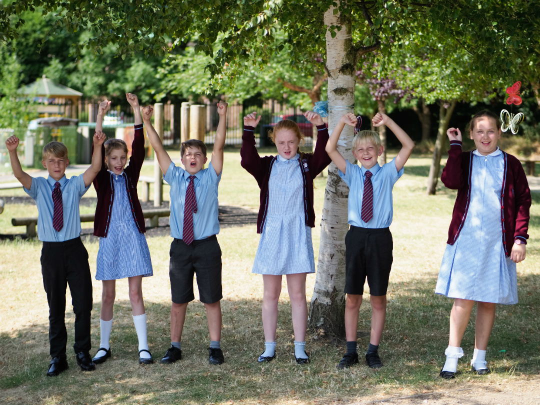 Children from St Columba's Catholic Primary in Huyton celebrate the school's Key Stage 2 results.