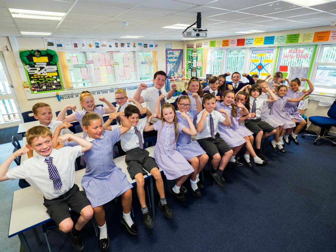 Children from St John Fisher Catholic Primary in Knowsley Village celebrate the school's Key Stage 2 results.