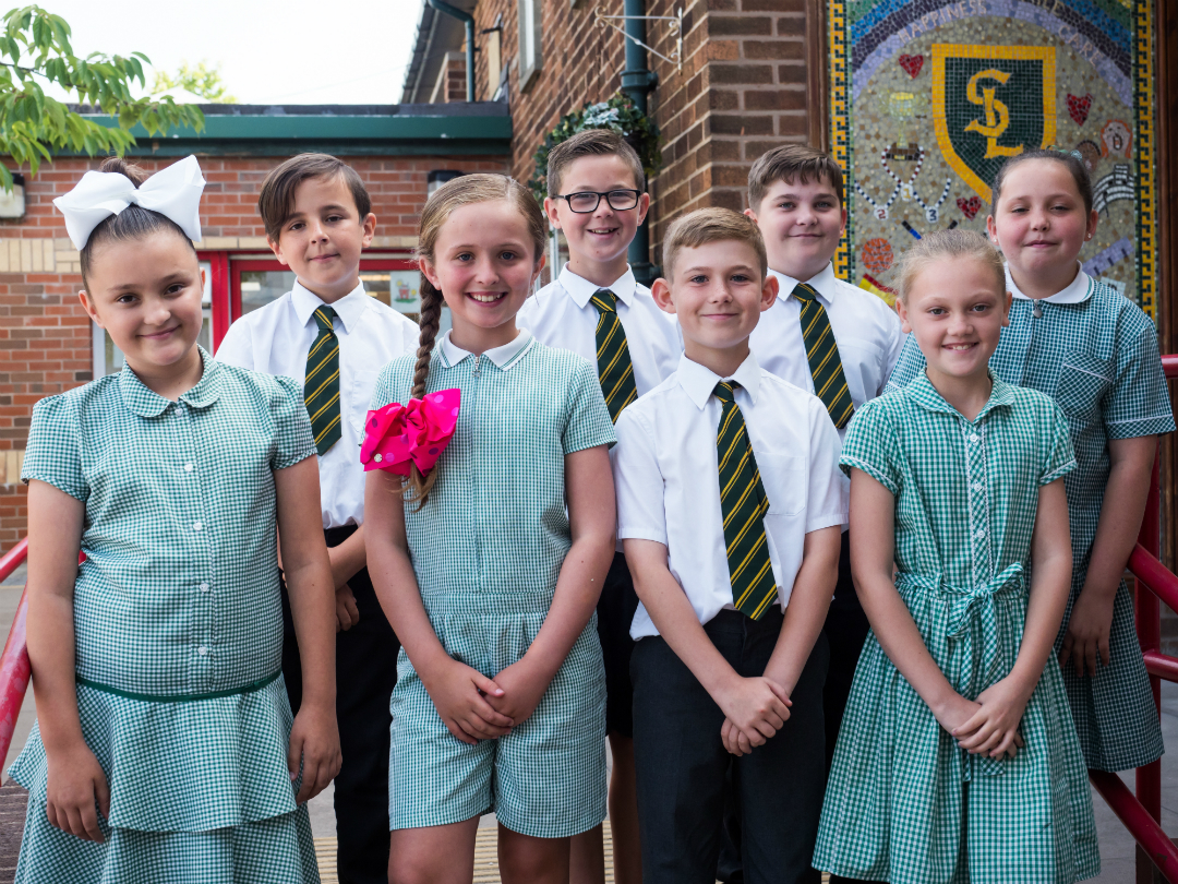 Children from St Laurence's Catholic Primary in Kirkby celebrate the school's Key Stage 2 results.