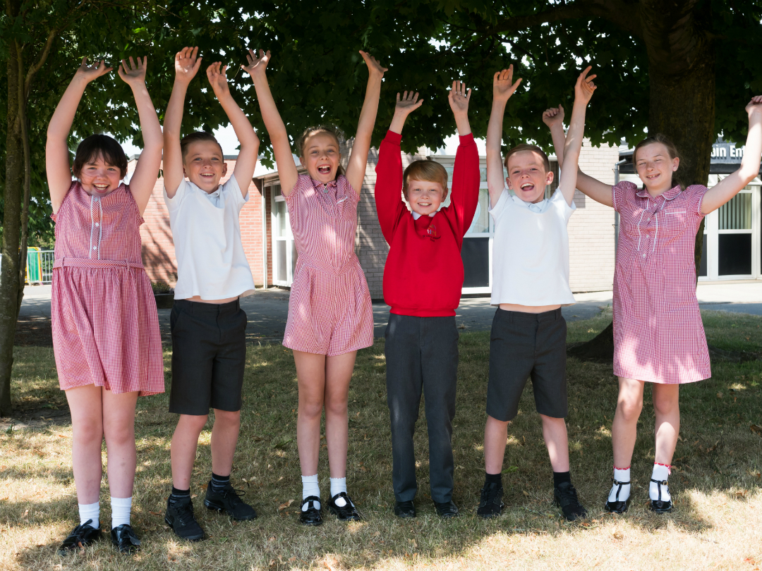 Children from St Leo's and Southmead Catholic Primary in Whiston celebrate the school's Key Stage 2 results