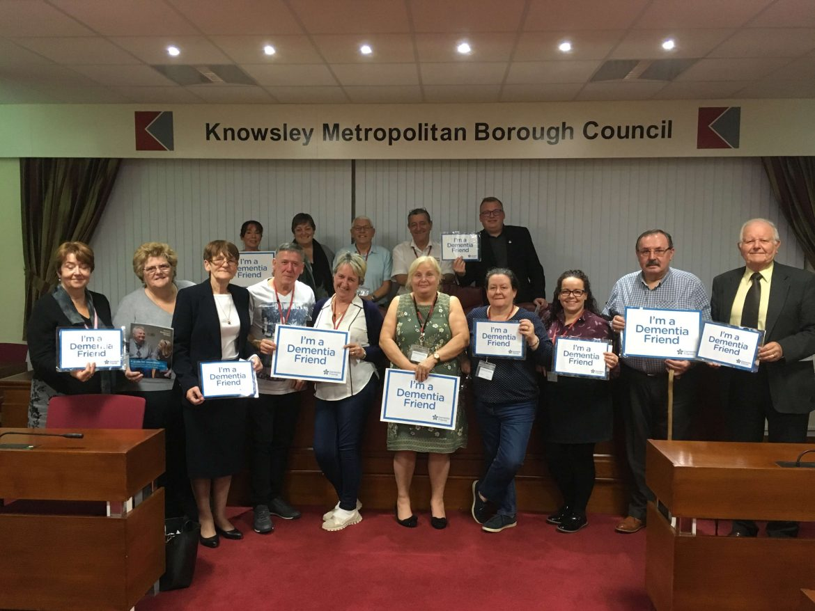 Councillors lined up with Dementia Friend signs