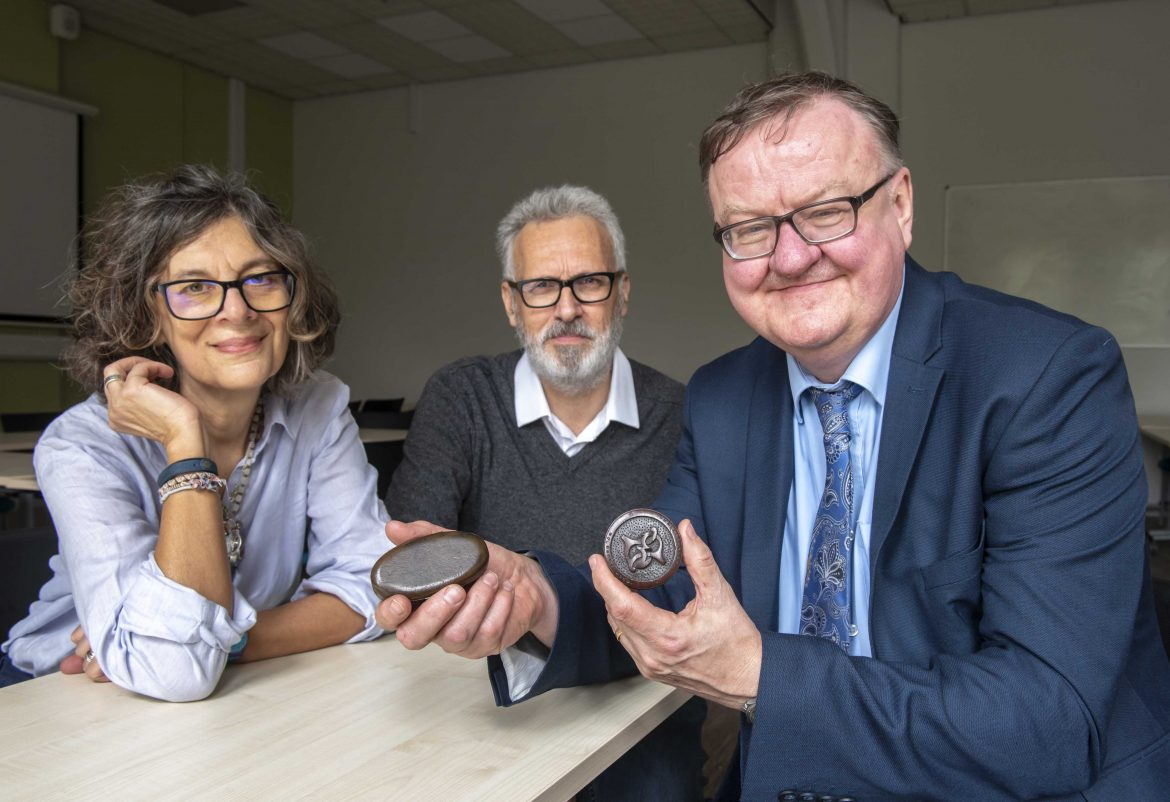 Elspeth Graham and Dr Stephen Bowe from Liverpool John Moores University donating his trinket boxes made from the wood of Shakespeare's mulberry tree, with Ian Tabbron Interim Chief Executive Shakespeare North Trust