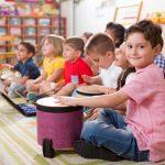 Nursery children playing drums