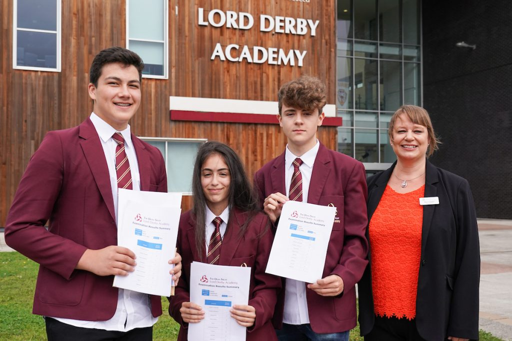 Lord Derby Academy students collect GCSE results with head teacher Vicky Gowan