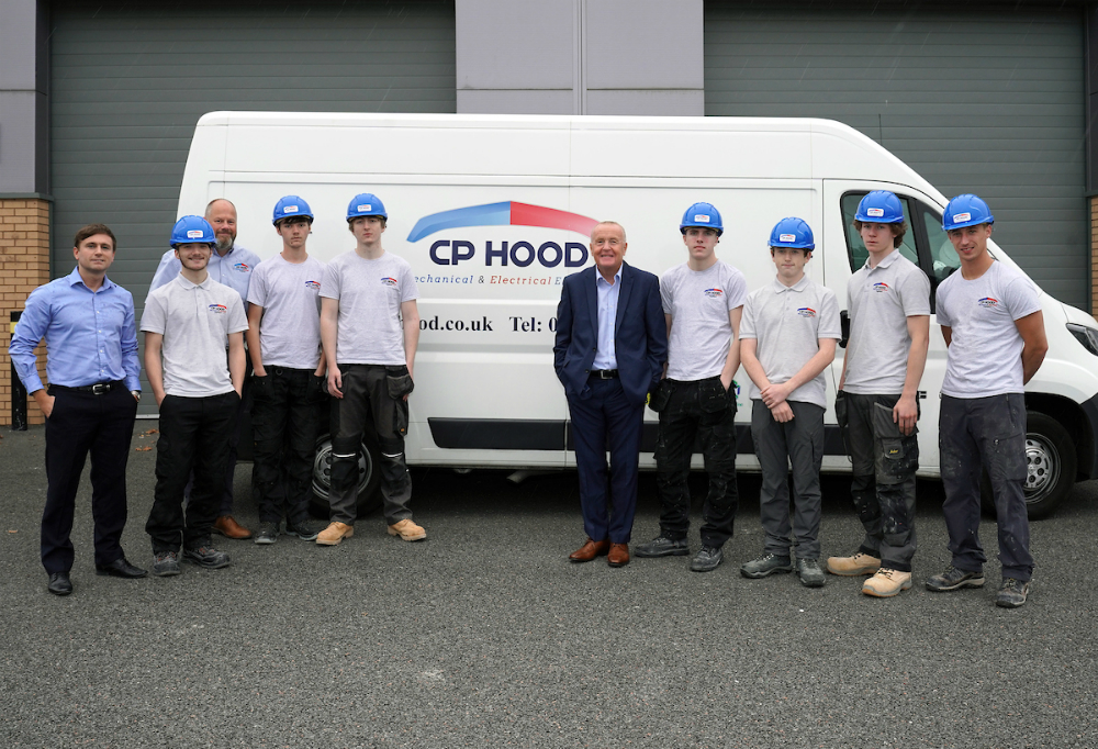 Apprentices from CP Hood pictures with Cllr Tony Brennan, Knowsley Council's Cabinet Member for Regeneration and Economic Development
