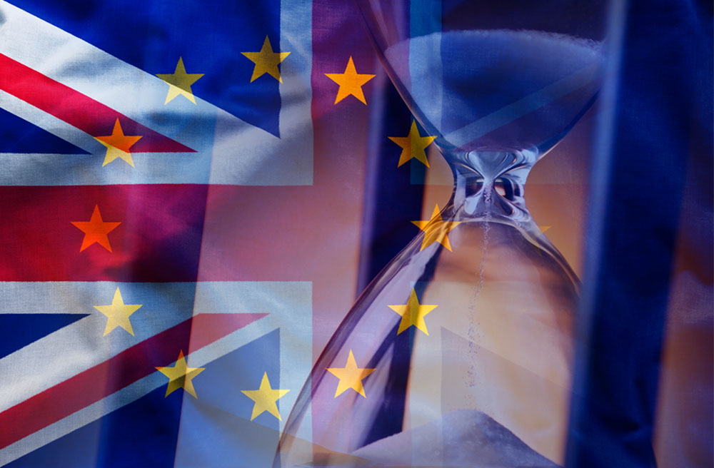 Brexit image UK and EU flags with sand timer