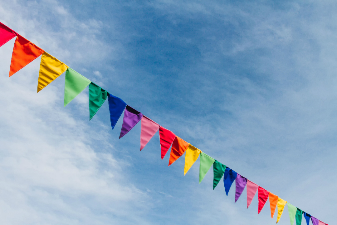 flags of colourful bunting against a blue sky