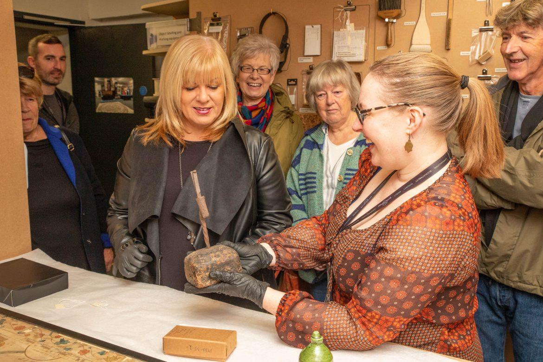 Cllr Shelley Powell with community curators at Prescot Musuem