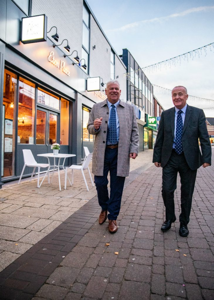Council Leader Cllr Graham Morgan and Cllr Tony Brennan, Cabinet Member for Regeneration and Economic Development, take a walk in Huyton Village where the first phase of shop front improvements are complete
