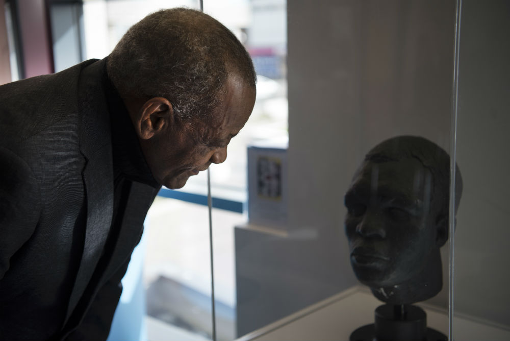 Louis Julienne, Director of the Heritage Development Company Liverpool viewing the bust of Kid Tanner on display courtesy of the Heritage Development Company Liverpool.