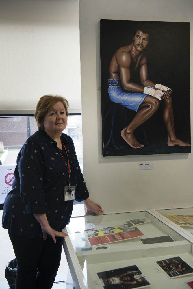 Gill Cowely with her portrait of John Conteh.