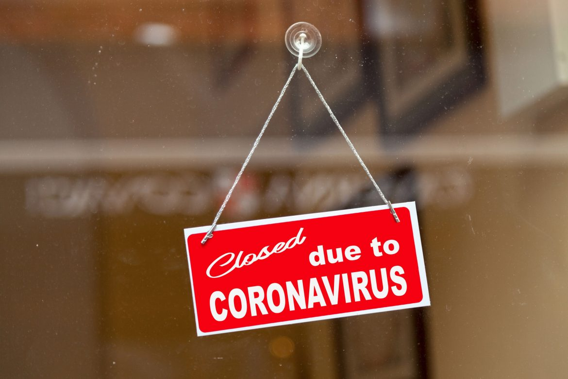 Sign in shop window says closed due to coronavirus