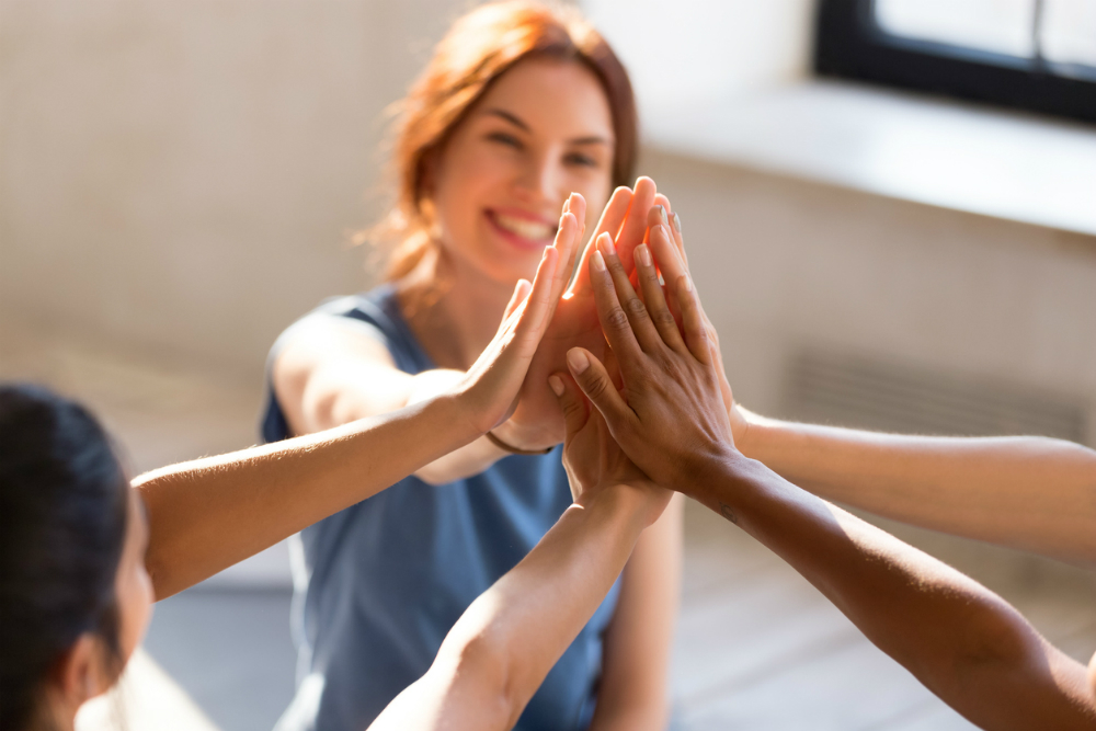 happy woman high fives others