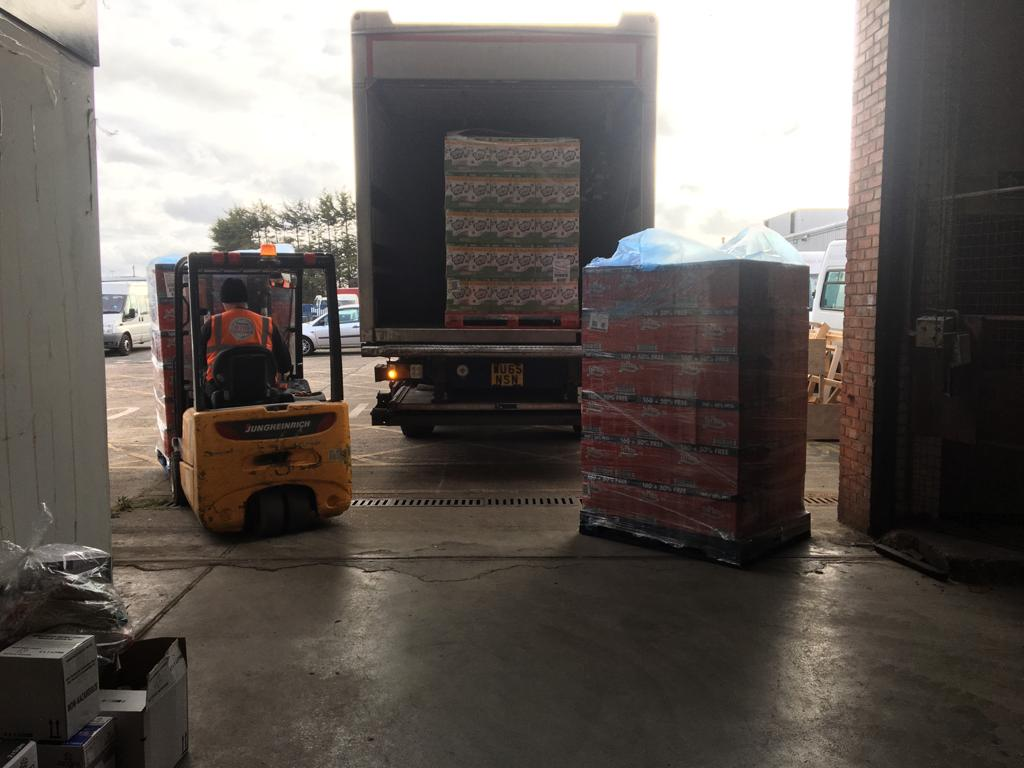 Food donated to the Knowsley Foodbank by Home Bargains being loaded into the wagon