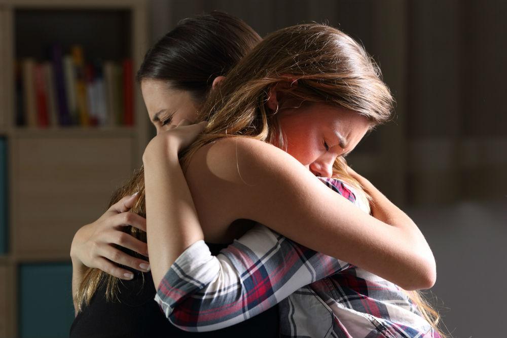 'girls hugging mother'