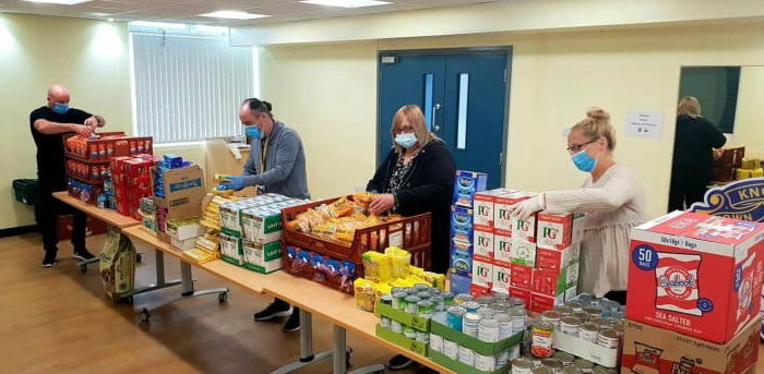 Town Councillors and volunteers package up items to go in the food parcels for local people