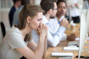 women sits in office looks worried
