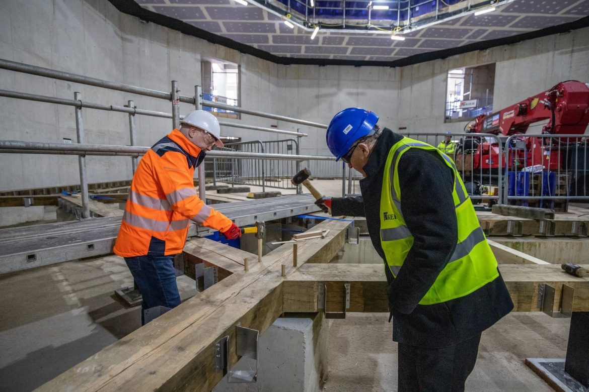 Cllr Tony Brennan and Mike Harden getting 'hands on' with the installation of the timber frame theatre at The Shakespeare North Playhouse