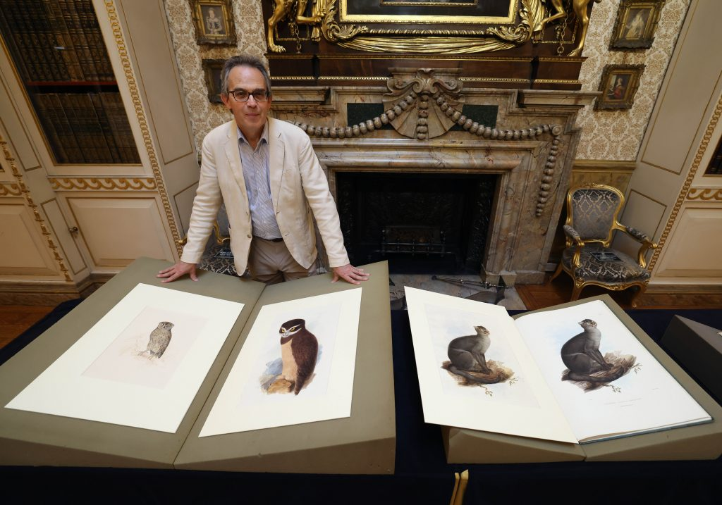 Dr Stephen Lloyd with original Edward Lear watercolour paintings from the Derby family's private collection.